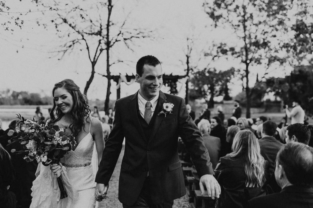 Bride and groom walk down the aisle at The Venue at Waterstone.
